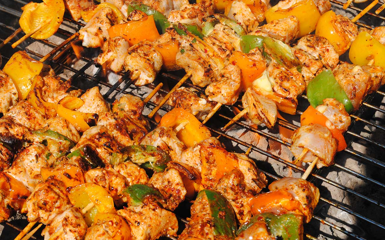 Mediterranean souvlaki sizzling on a summer's day